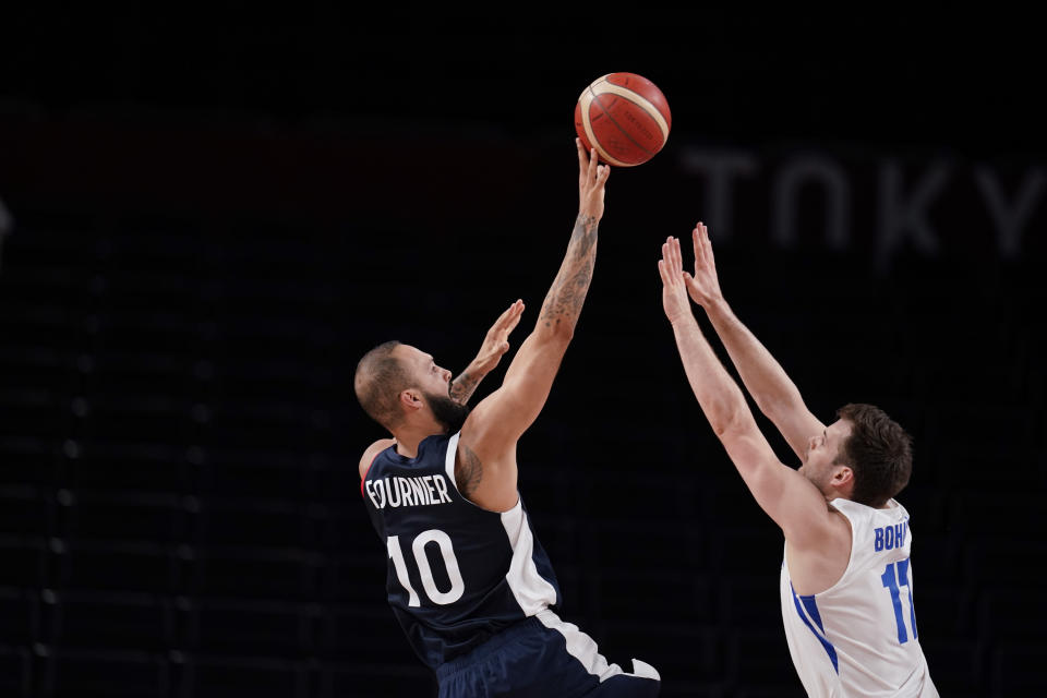 France's Evan Fournier (10) shoots on Czech Republic's Jaromir Bohacik (17) during a men's basketball preliminary round game at the 2020 Summer Olympics in Saitama, Japan, Wednesday, July 28, 2021. (AP Photo/Charlie Neibergall)