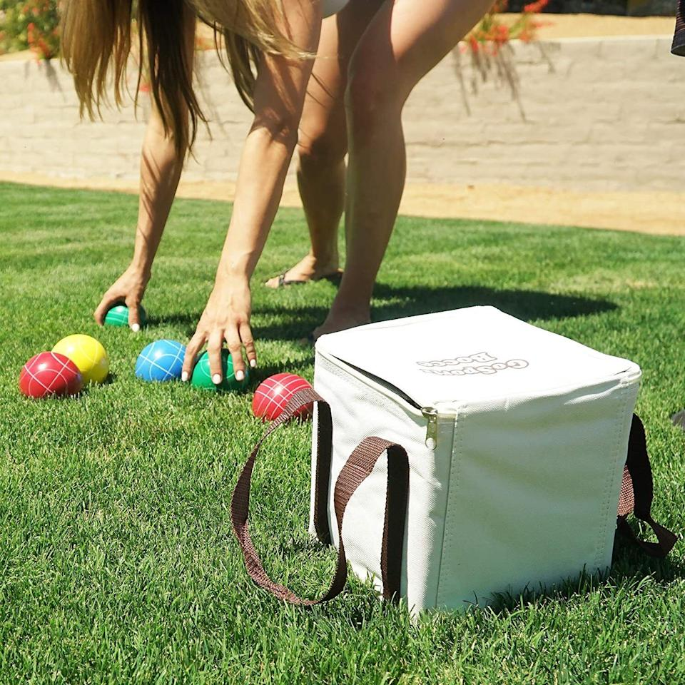 """This game will give you hours of backyard play with the fam on sunny days. Bonus: You'll also get a killer arm and wrist workout.<br /><br /><strong>Promising review:</strong>""""We have had a few other bocce sets and this one is by far the best. The balls are solid, not water filled, like some others.<strong>The balls are a good size, nice weight, and the finish is durable. We like the carrying case as well as the rope for measuring, both of these were additional features that we didn't receive with previous (other brand) sets.</strong>We use the set in our backyard and its been great!"""" —<a href=""""https://amzn.to/3dGr1pa"""" target=""""_blank"""" rel=""""nofollow noopener noreferrer"""" data-skimlinks-tracking=""""5580838"""" data-vars-affiliate=""""Amazon"""" data-vars-href=""""https://www.amazon.com/gp/customer-reviews/R122M6AHO70OS7?tag=bfgenevieve-20&ascsubtag=5580838%2C9%2C33%2Cmobile_web%2C0%2C0%2C1159989"""" data-vars-keywords=""""cleaning,fast fashion"""" data-vars-link-id=""""1159989"""" data-vars-price="""""""" data-vars-product-id=""""16176802"""" data-vars-retailers=""""Amazon"""">Amazon Customer</a><br /><br /><strong>Get it from Amazon for <a href=""""https://amzn.to/3tLJINM"""" target=""""_blank"""" rel=""""noopener noreferrer"""">$39.99+</a> (also available in a soft rubber ball set and a light-up LED ball set).</strong>"""