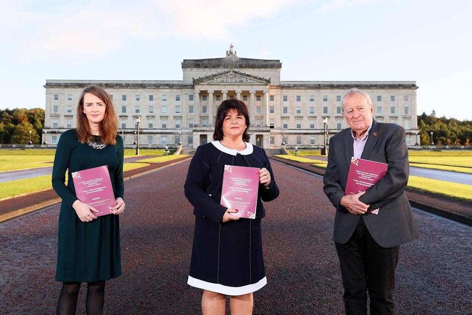Dr Maeve O'Rourke (left), Deirdre Mahon and Professor Phil Scraton launch the report outside Stormont (PA) (PA Media)