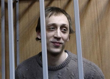 File photo of dancer Dmitrichenko looking out from the defendant's holding cell during a hearing in Moscow