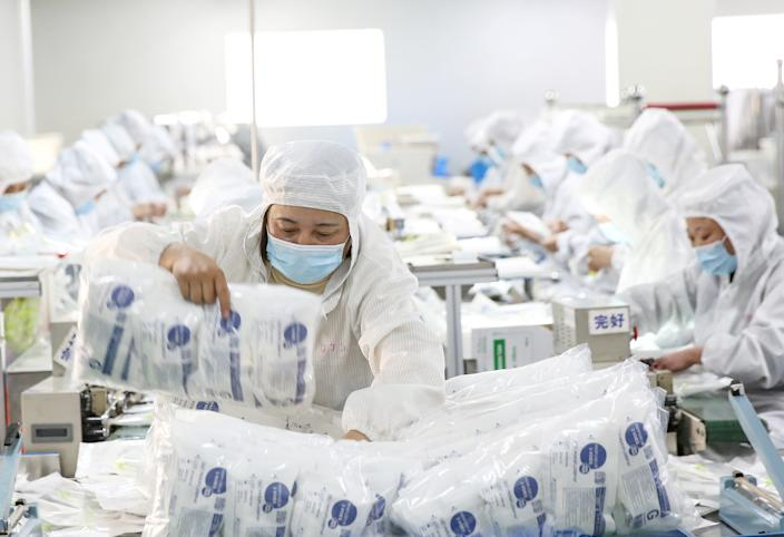 A medical supply production line at a factory in Huaian, China. (China Daily via Reuters)