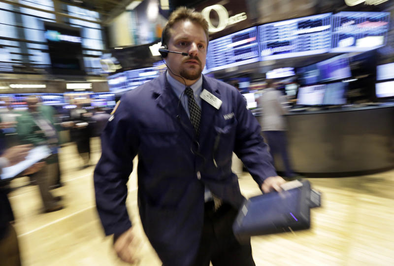 Trader Michael Milano works on the floor of the New York Stock Exchange Friday, July 5, 2013. Robust hiring in the U.S. is boosting the stock market in early trading. (AP Photo/Richard Drew)