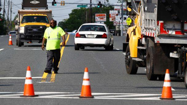 PHOTO: An emergency vehicle passes a roadblock near a scene, May 21, 2018, in Perry Hall, Md. (Patrick Semansky/AP)