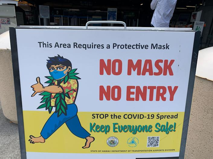 A masking requirement sign at the Kona airport on the island of Hawaii.