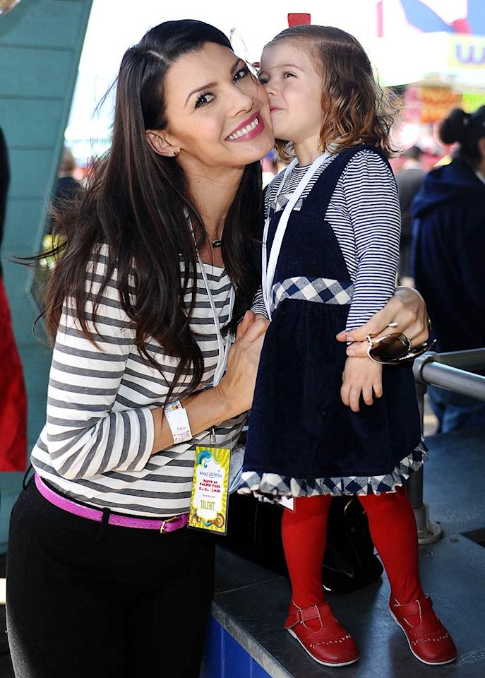 """Aw! Ali Landry's adorable daughter Estela planted a kiss on the former Miss USA's cheek at the Make-A-Wish Foundation's Day of Fun on the Santa Monica Pier in L.A. Stefanie Keenan/<a href=""""http://www.gettyimages.com/"""" target=""""new"""">GettyImages.com</a> - March 14, 2010"""