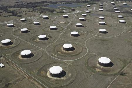 Crude oil storage tanks are seen from above at the Cushing oil hub in Cushing
