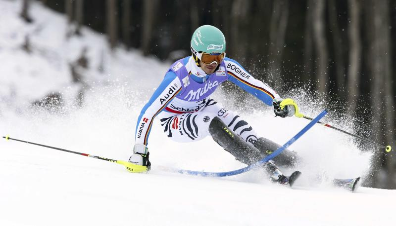 Germany's Felix Neureuther clears a gate during the first run of the men's slalom, at the Alpine skiing world championships in Schladming, Austria, Sunday, Feb.17, 2013. (AP Photo/Alessandro Trovati)