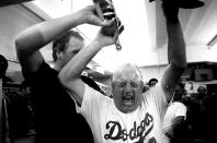 Pitcher Tom Niedenfuer pours champagne on manager Tommy Lasorda in the clubhouse after winning the 1981 NLDS playoffs at Dodger Stadium, Los Angeles, California. (Photo by Jayne Kamin-Oncea/Getty Images)