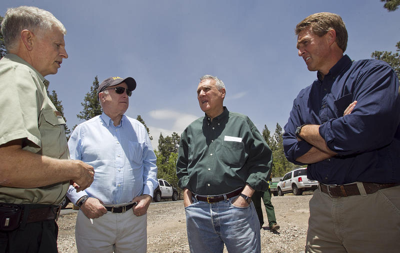 Thomas Tidwell, of the Forest Service, left, briefs Sen. John McCain, Sen. Jon Kyl, Rep. Jeff Flake, in the forest surrounding Alpine, Ariz. Saturday, June 18, 2011 during a tour of the burned areas of the Wallow Fire. The fire has burned more than 500,000 acres in eastern Arizona.   (AP Photo/The Arizona Republic, Tom Tingle)  MARICOPA COUNTY OUT; MAGS OUT; NO SALES