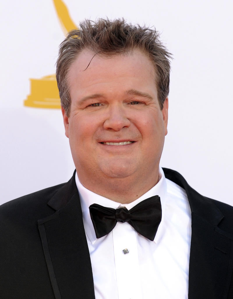 """Actor Eric Stonestreet arrives at the 64th Primetime Emmy Awards at the Nokia Theatre on Sunday, Sept. 23, 2012, in Los Angeles.  Stonestreet is nominated for best supporting actor in a comedy for his role on """"Modern Family."""" (Photo by Jordan Strauss/Invision/AP)"""