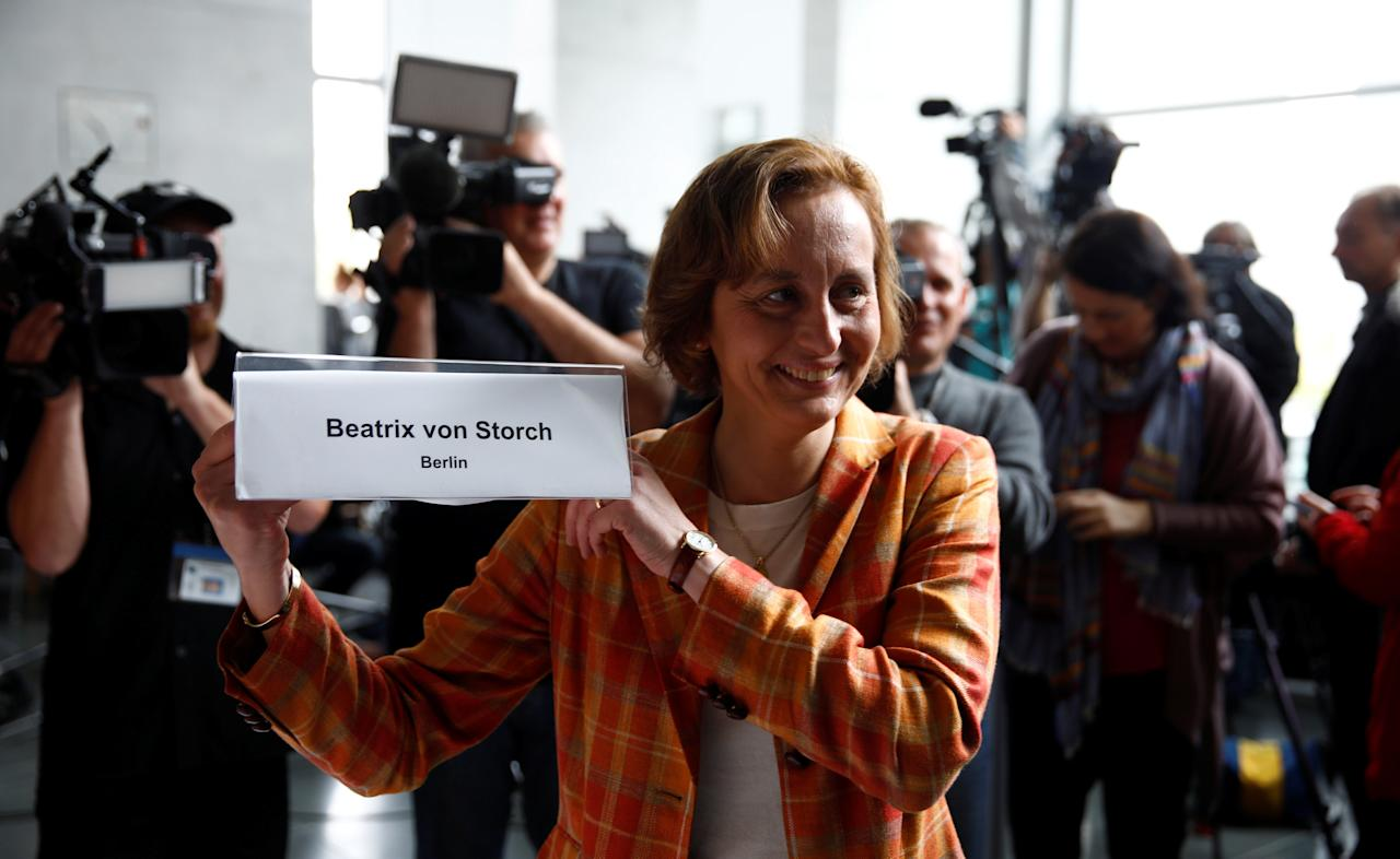 Anti-immigration party Alternative fuer Deutschland AfD party member Beatrix von Storch holds her name sign before a get together for their first parliamentary meeting in Berlin, Germany September 26, 2017.     REUTERS/Axel Schmidt