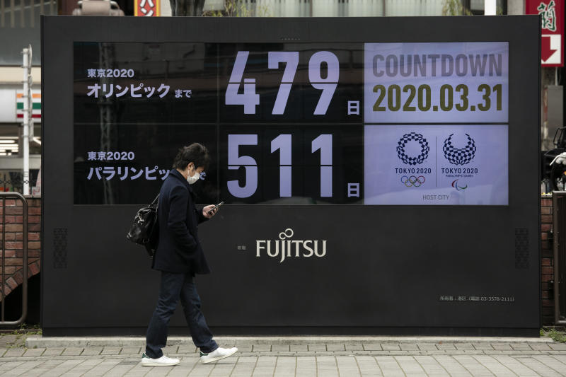 A man walks past a countdown display for the Tokyo 2020 Olympics and Paralympics Tuesday, March 31, 2020, in Tokyo. The countdown clock is ticking again for the Tokyo Olympics. They will be July 23 to Aug. 8, 2021. The clock read 479 days to go. This seems light years away, but also small and insignificant compared to the worldwide fallout from the coronavirus. (AP Photo/Jae C. Hong)