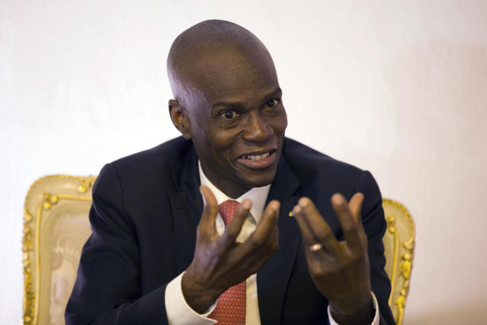 FILE - In this Aug. 28, 2019, file photo, Haiti's President Jovenel Moise speaks during an interview in his office in Port-au-Prince, Haiti. Moïse was assassinated after a group of unidentified people attacked his private residence, the country's interim prime minister said in a statement Wednesday, July 7, 2021. Moïse's wife, First Lady Martine Moïse, is hospitalized, interim Premier Claude Joseph said. (AP Photo/Dieu Nalio Chery, File)