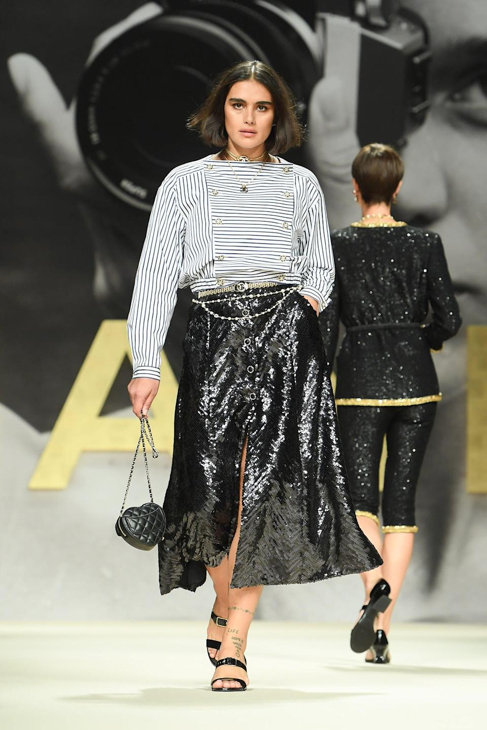 PARIS, FRANCE - OCTOBER 05: (EDITORIAL USE ONLY - For Non-Editorial use please seek approval from Fashion House) A model walks the runway during the Chanel Womenswear Spring/Summer 2022 show as part of Paris Fashion Week on October 05, 2021 in Paris, France. (Photo by Stephane Cardinale - Corbis/Corbis via Getty Images)