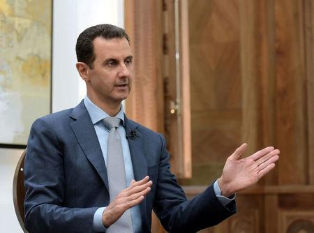 Syria's President Bashar al-Assad speaks during an interview with Yahoo News