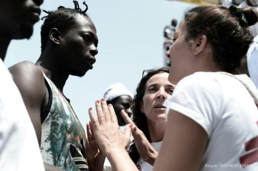 NGO workers reassured migrants on board the Aquarius to avoid panic