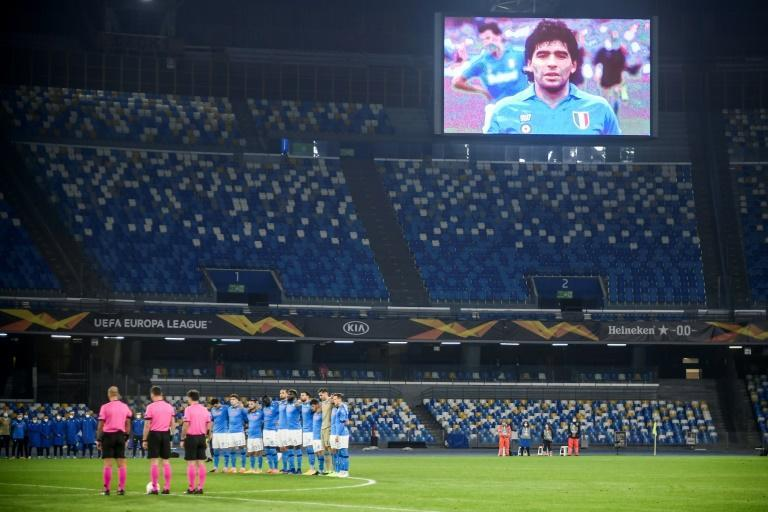 A screen displays a photo of Diego Maradona in the stadium of Napoli, the club he led to two Italian titles