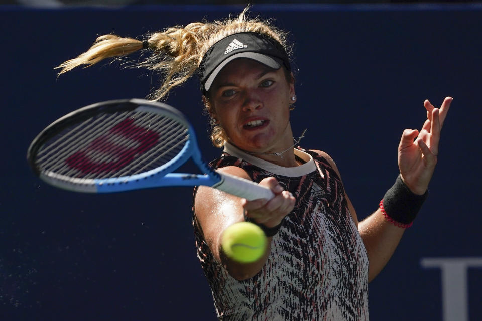 Catherine McNally, of the United States, returns a shot to Karolina Pliskova, of the Czech Republic, during the first round of the US Open tennis championships, Tuesday, Aug. 31, 2021, in New York. (AP Photo/John Minchillo)
