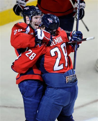 Washington Capitals left wing Troy Brouwer (20) celebrates his goal with teammate Alexander Semin (28), of Russia, during the first period of an NHL hockey game against the Tampa Bay Lightning, Friday, Jan. 13, 2012, in Washington. (AP Photo/Nick Wass)
