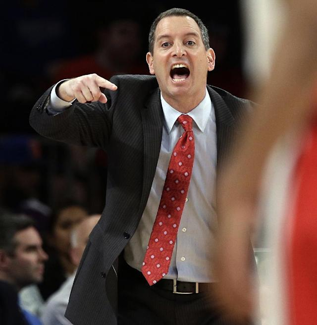 """FILE - In this March 12, 2013, file photo, Rutgers coach Mike Rice yells out to his team during an NCAA college basketball game against DePaul at the Big East tournament in New York. The videotape, broadcast Tuesday, April 2, on ESPN, prompted scores of outraged social media comments as well as sharp criticism from Gov. Chris Christie and NBA star LeBron James. The video tape shows Rice shoving, grabbing and throwing balls at players in practice and using gay slurs. Rice talks about the scandal on ABC's """"20/20"""" on Friday, Nov. 8, 2013. (AP Photo/Frank Franklin II, File)"""