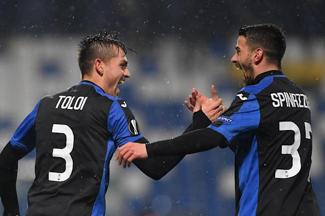 Soccer Football - Europa League Round of 32 Second Leg - Atalanta vs Borussia Dortmund - Stadio Atleti Azzurri, Bergamo, Italy - February 22, 2018 Atalanta's Rafael Toloi celebrates with Leonardo Spinazzola after scoring their first goal REUTERS/Alberto Lingria