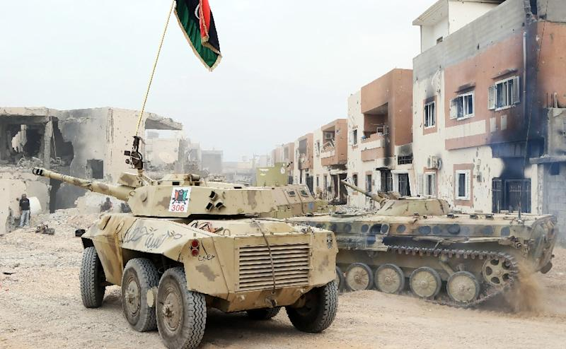 Infantry fighting vehicles belonging to forces loyal to Libya's Government of National Accord take position in Sirte's Al-Giza Al-Bahriya district on November 21, 2016