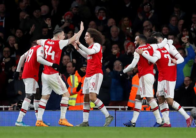 Arsenal players celebrate with match-winner Reiss Nelson (Action Images via Reuters/Matthew Childs)