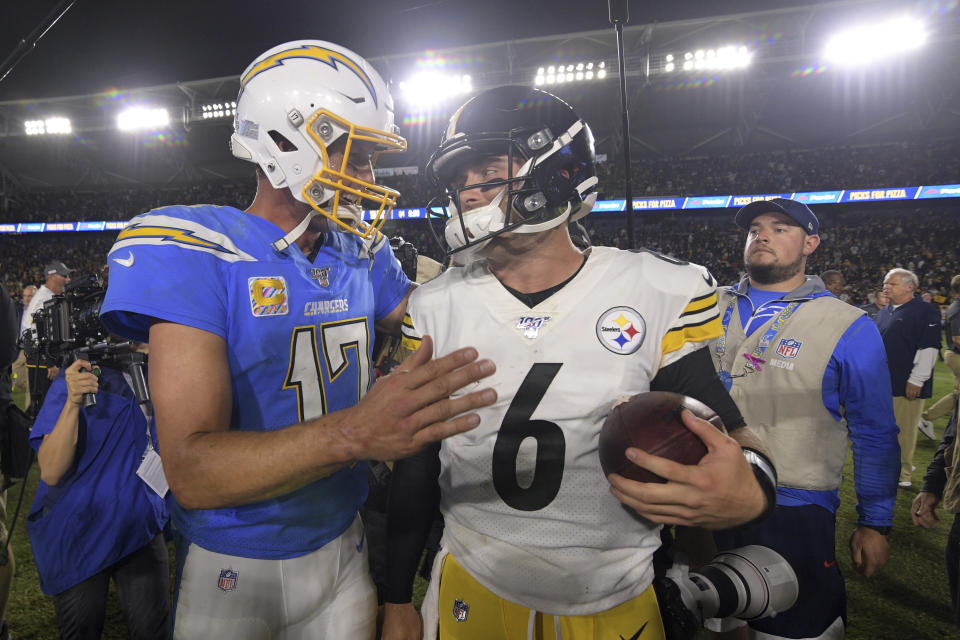 Los Angeles Chargers quarterback Philip Rivers, left, and Pittsburgh Steelers quarterback Devlin Hodges greet each other after an NFL football game, Sunday, Oct. 13, 2019, in Carson, Calif. (AP Photo/Kyusung Gong)