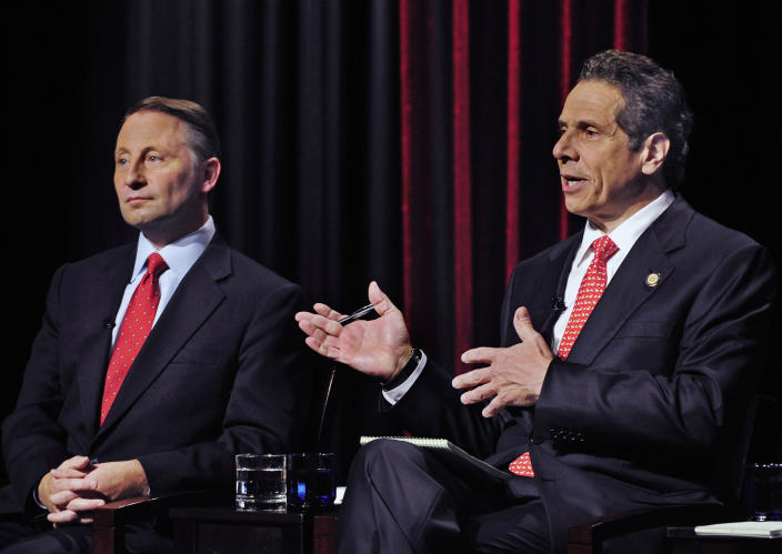 FILE — In this Oct. 22, 2014 file photo, New York State Republican gubernatorial candidate Rob Astorino, left, listens to the response of Democratic incumbent Andrew Cuomo, during a debate, in Buffalo , N.Y. New York's attorney general has promised a thorough investigation of allegations that Cuomo sexually harassed at least two women. (AP Photo/Gary Wiepert, File)