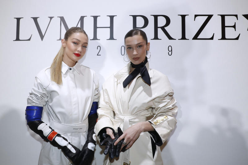PARIS, FRANCE - MARCH 01: Models Bella Hadid and her sister Gigi Hadid attend the LVMH Prize 2019 Edition at Louis Vuitton Avenue Montaigne Store on March 01, 2019 in Paris, France. (Photo by Bertrand Rindoff Petroff/Getty Images)