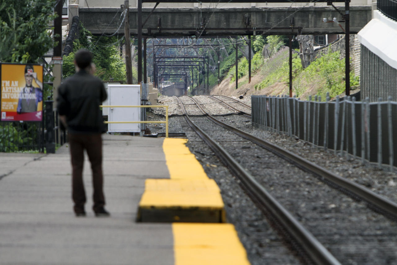 Unaware of the work stoppage Roy Pearson waits for a SEPTA commuter train at the East Falls commuter rail station in Philadelphia on Saturday June 14, 2014. Pennsylvania Gov. Tom Corbett asked President Barack Obama on Saturday to intervene the dispute between the Southeast Pennsylvania Transportation Authority and its engineers and electricians unions, which went on strike at midnight Friday, June 13. (AP Photo/ Joseph Kaczmarek)