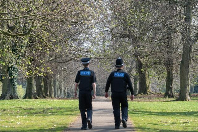 Police officers patrol a park in Northampton