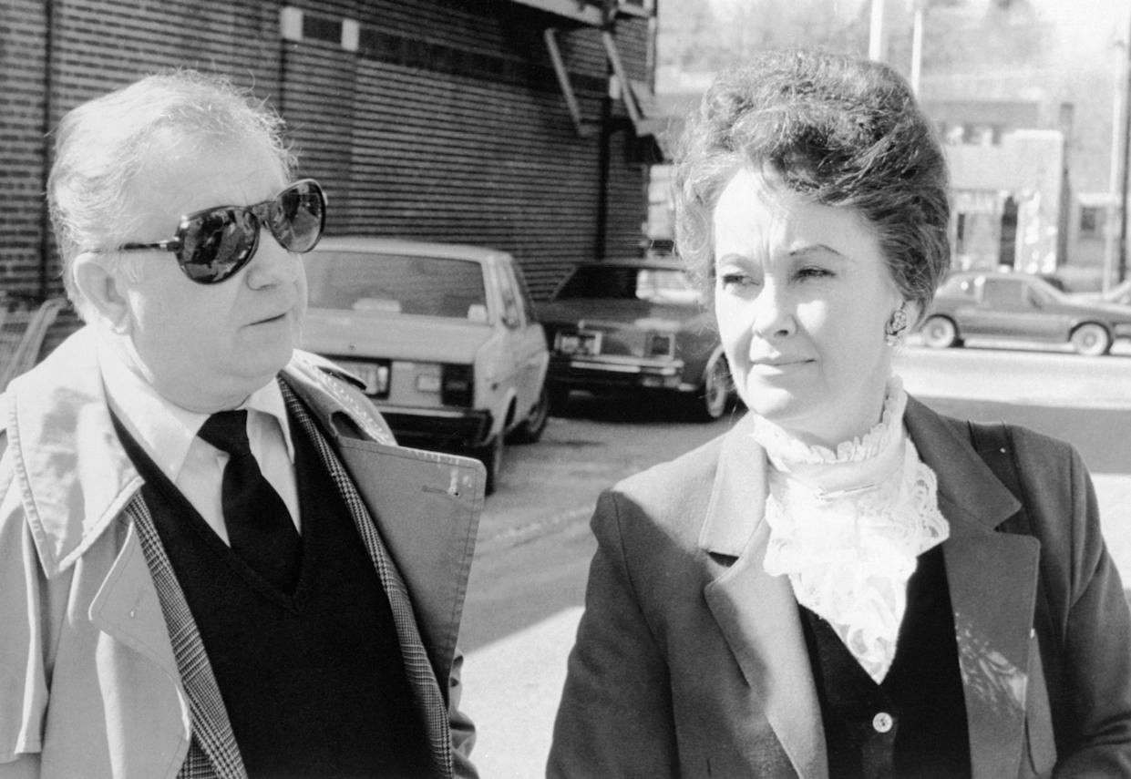 (Original Caption) Ed and Lorraine Warren arrives at Danbury Superior Court, March 19, 1981, where a grand jury returned an indictment against Arne Cheyenne Johnson in the slaying of Alan Bono, 40, on February 16, 1981, in Broofield, Connecticut. Lorraine Warren was one of the persons to talk with the 19 year old man after the slaying which his attorney says was the work of the devil.