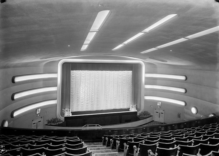 <p>The Odeon Cinema in Surbiton, Surrey opened in 1934. The theater is designed in the art deco style. Its first show was <em>Captain Blood </em>starring Errol Flynn<em>. </em>The Odeon closed in 1975 and was eventually demolished in 1998.</p>