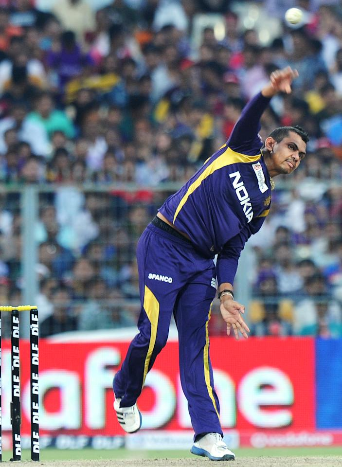 Kolkata Knight Riders cricketer Sunil Narine bowls during the IPL Twenty20 cricket match between Kolkata Knight Riders and Kings XI Punjab at The Eden Gardens in Kolkata on April 15, 2012. RESTRICTED TO EDITORIAL USE. MOBILE USE WITHIN NEWS PACKAGE. AFP PHOTO/Dibyangshu SARKAR (Photo credit should read DIBYANGSHU SARKAR/AFP/Getty Images)