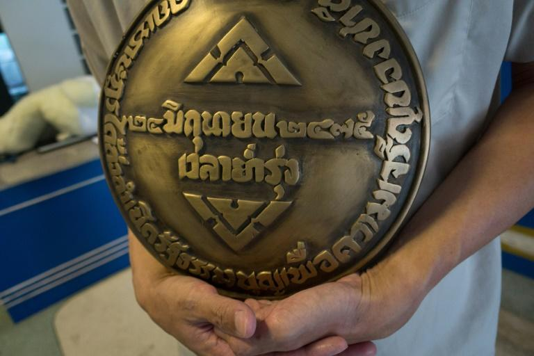 The original was suddenly replaced in April with a new plaque espousing loyalty to Thailand's monarchy, an institution whose influence has roared back into prominence over the past 85 years as democracy has faltered