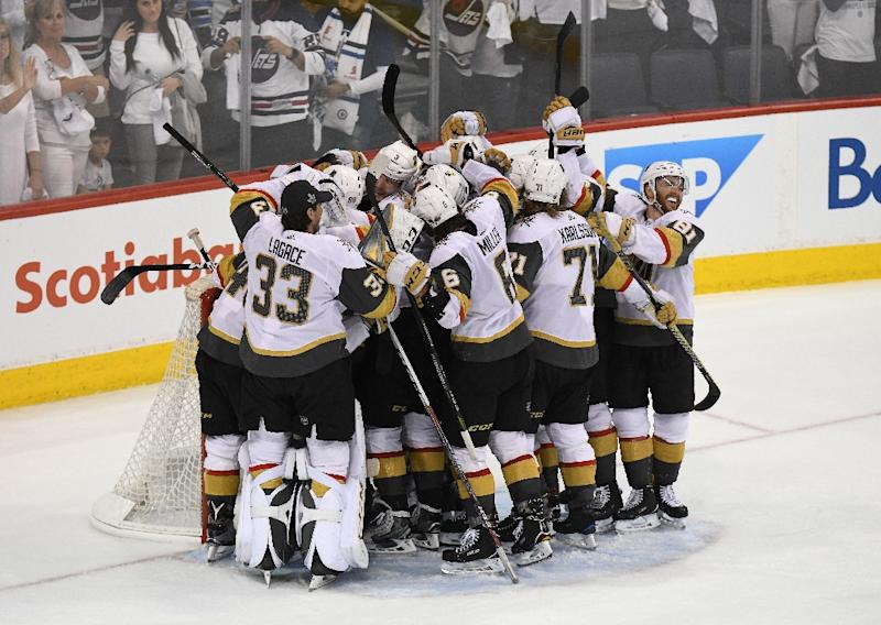 The Vegas Golden Knights celebrate defeating the Winnipeg Jets 2-1 in Game Five of the Western Conference Finals to advance to the 2018 NHL Stanley Cup Final (AFP Photo/David Lipnowski)