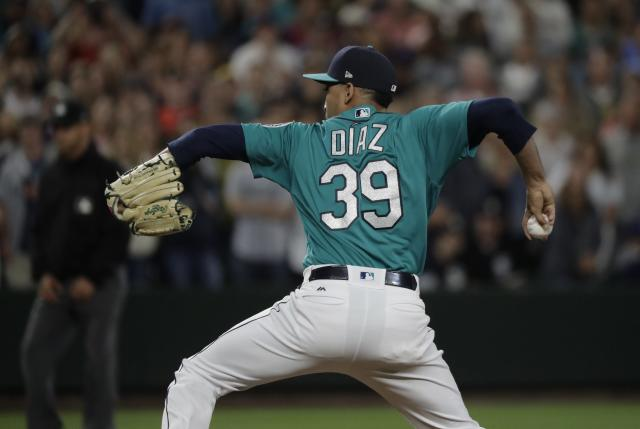 Seattle Mariners closing pitcher Edwin Diaz throws against the Chicago White Sox during a baseball game, Friday, July 20, 2018, in Seattle. (AP Photo/Ted S. Warren)