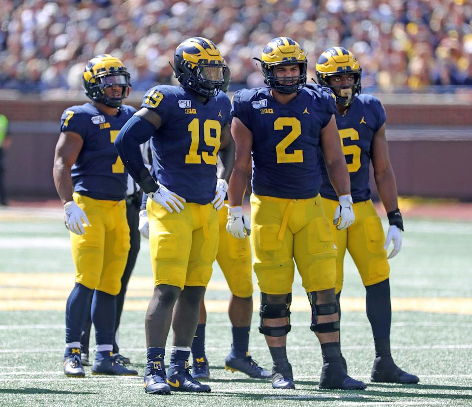 Michigan Wolverines' Kwity Paye (19), Carlo Kemp (2) and Josh Uche (6) during action against Army, Sept. 7, 2019 at Michigan Stadium.