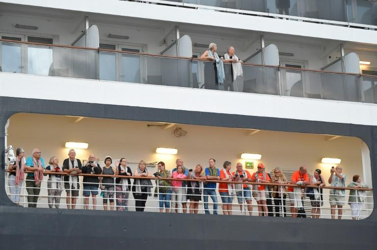 Passengers aboard the Westerdam have been allowed to land in Cambodia after two weeks at sea with various Asian ports refusing them entry (AFP Photo/TANG CHHIN Sothy)