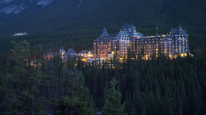 """<p>Located in the heart of Banff National Park, the <a href=""""https://www.fairmont.com/banff-springs/"""" rel=""""nofollow noopener"""" target=""""_blank"""" data-ylk=""""slk:Fairmont Banff Springs"""" class=""""link rapid-noclick-resp"""">Fairmont Banff Springs</a> draws on architectural elements from Scottish Baronial castles. The magnificent structure designed by Walter Painter, formerly known as the Banff Springs Hotel, was one of the earliest of Canada's grand railway hotels. </p><p>Named a UNESCO World Heritage site, the Castle of the Rockies continues to welcome guests to enjoy its marvelous 300 guest rooms, aromatherapy saunas, and golf course. </p>"""