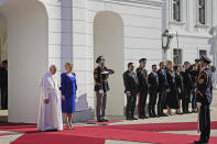 Pope Francis, flanked by Slovakian President Zuzana Caputova, right, attends a welcoming ceremony at the presidential palace in Bratislava, Slovakia, Monday, Sept. 13, 2021. Francis is on a four-day visit to Central Europe, in Hungary and Slovakia, in his first big international outing since undergoing intestinal surgery in July. (AP Photo/Gregorio Borgia)