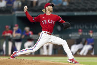 Texas Rangers starting pitcher Mike Foltynewicz (20) throws during the first inning of a baseball game against the Minnesota Twins in Arlington, Texas, Friday, June 18, 2021. (AP Photo/Andy Jacobsohn)