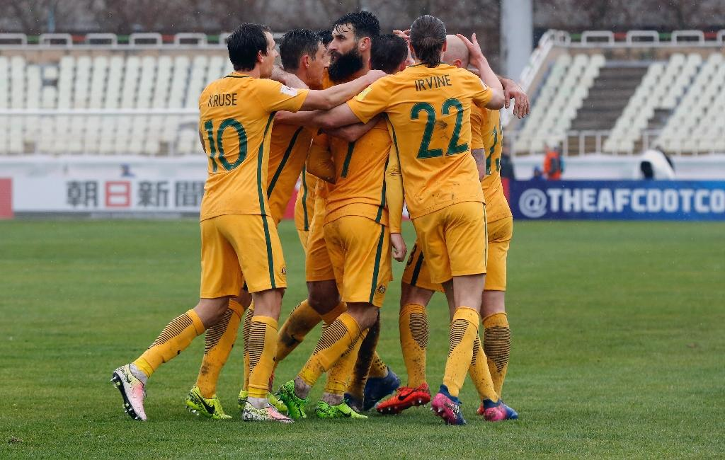 Australia players celebrate a goal during their FIFA World Cup 2018 qualifier against Iraq at Shahid Dastgerdi Stadium in the Iranian capital Tehran on March 23, 2017 (AFP Photo/STR)