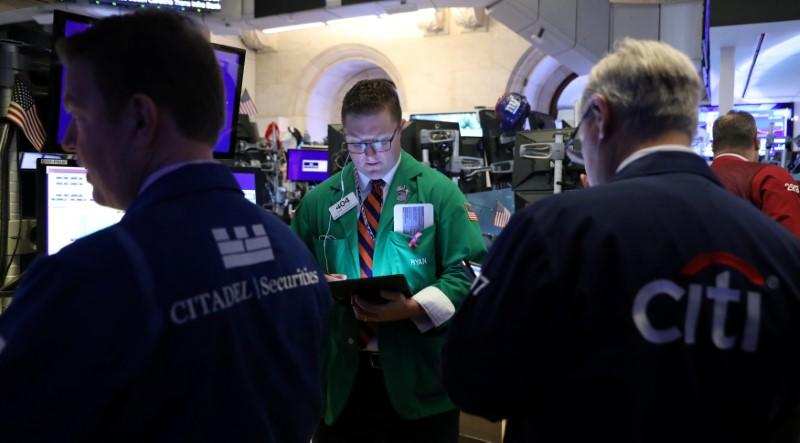 Traders work on the floor at the New York Stock Exchange (NYSE) in New York, U.S., May 14, 2019. REUTERS/Brendan McDermid