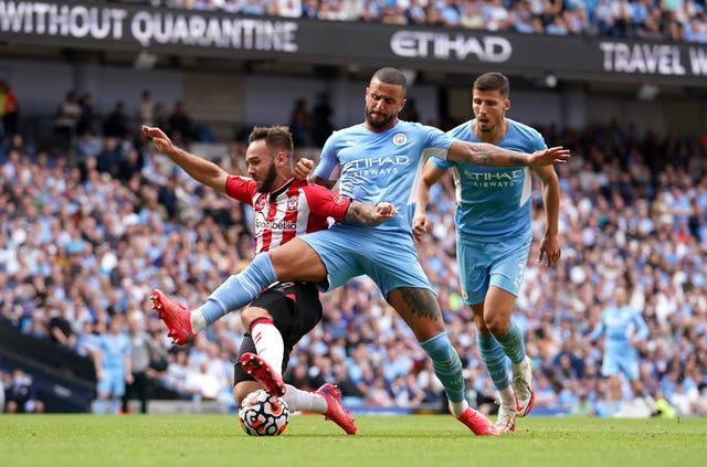 Kyle Walker challenges Southampton's Adam Armstrong