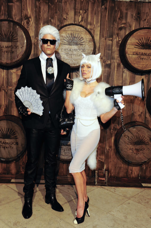 <p>Sniff! Before their split, the duo were known for their matching costumes on Halloween. One of their funniest (yet chicest) costume choices was Chanel designer Karl Lagerfeld and his cat, Choupette. (Photo: Getty Images) </p>