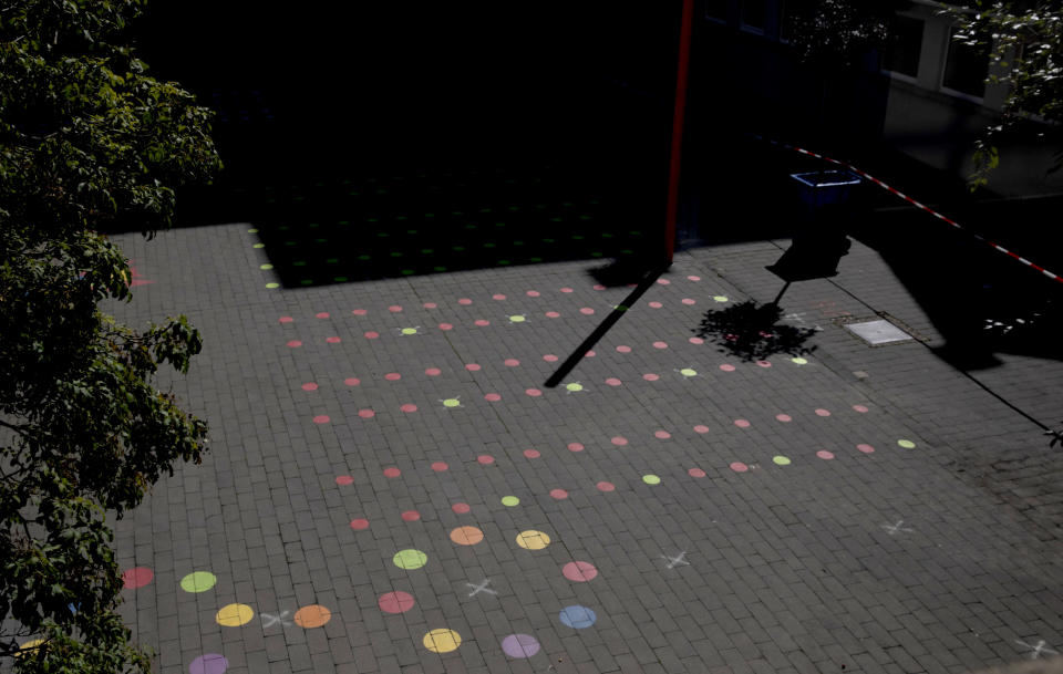 Social distancing markers due to coronavirus, COVID-19 measures line a play area in the elementary school section of the Atheneum school in Antwerp, Belgium, Monday, Aug. 31, 2020. Students return to school in Belgium on Tuesday, Sept. 1, with measures in place regarding social distancing and the wearing of masks to protect against the spread of coronavirus, COVID-19. (AP Photo/Virginia Mayo)