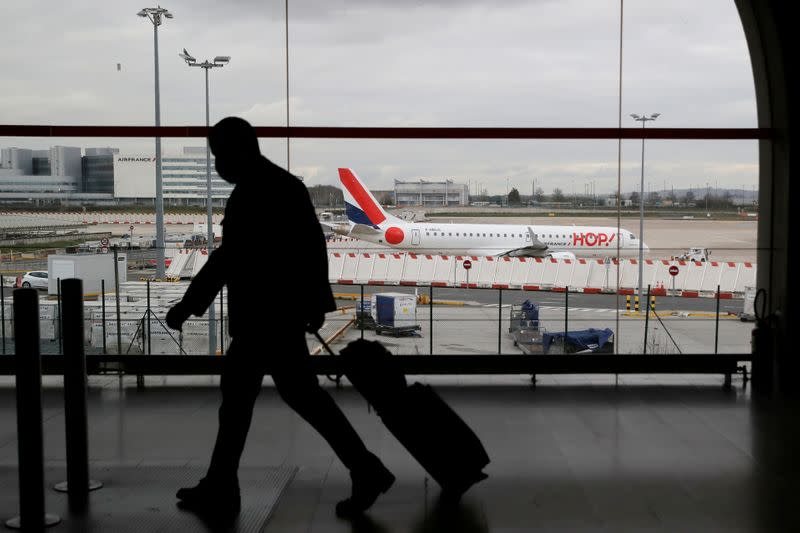 FILE PHOTO: Police measures and sanitary checks at Roissy airport after French borders closed to non-essential travel