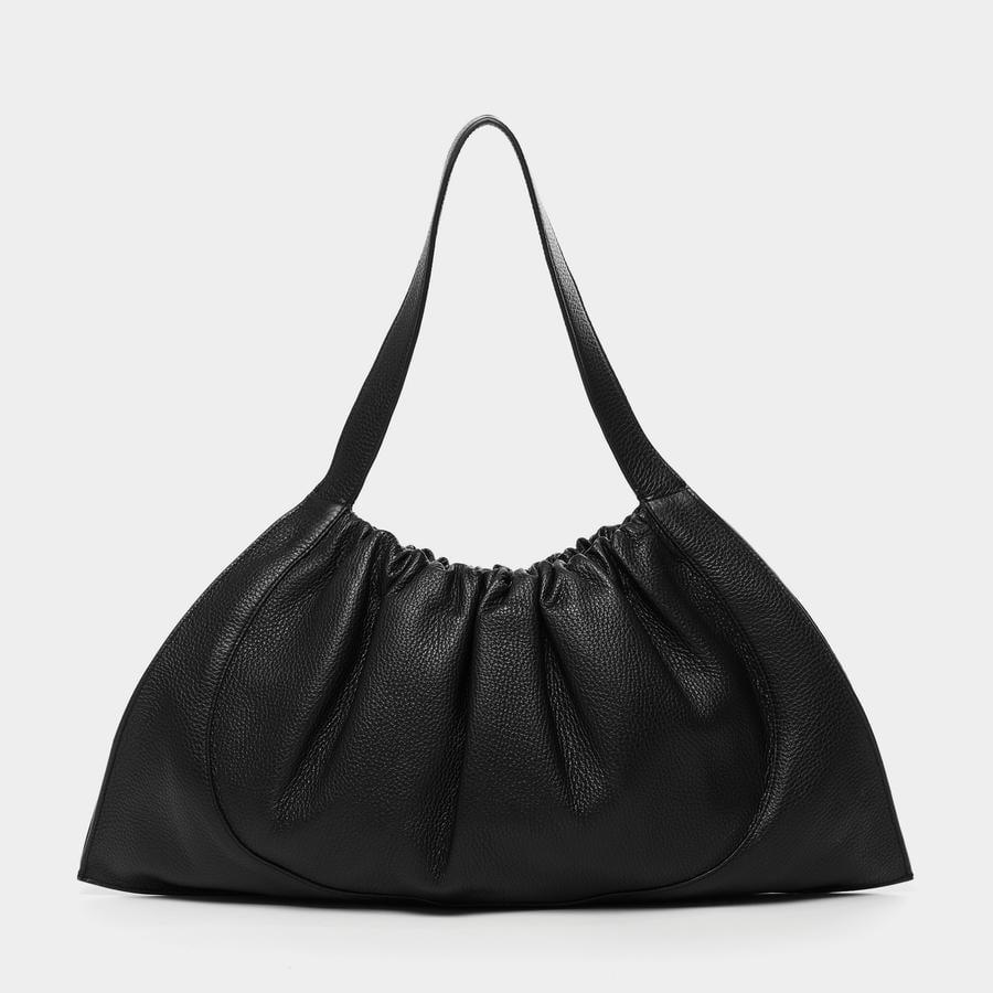 <p>If you want plenty of space, this <span>Ana Flat Tote</span> ($300) will be your favorite. It comes in red or white as well.</p>